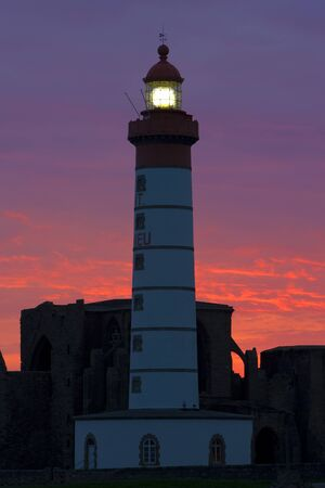 auroral: lighthouse and ruins of monastery, Pointe de Saint Mathieu, Brittany, France