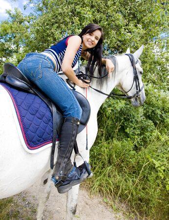 dark haired woman: equestrian on horseback