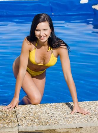 dark haired woman: woman in swimming pool