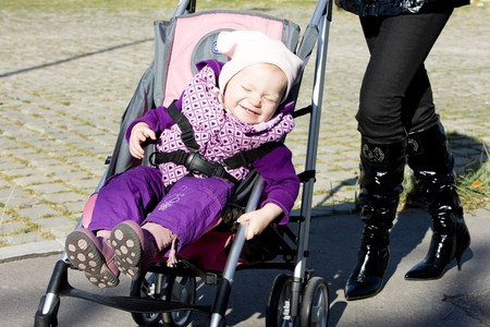 woman with toddler sitting in pram on walk Stock Photo - 7343131