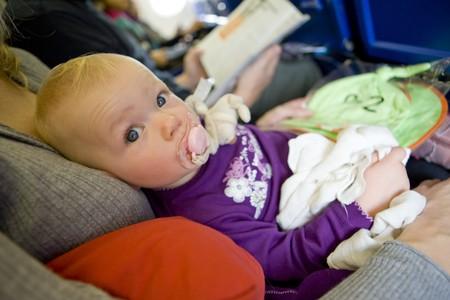 toddler girl sitting on plane photo