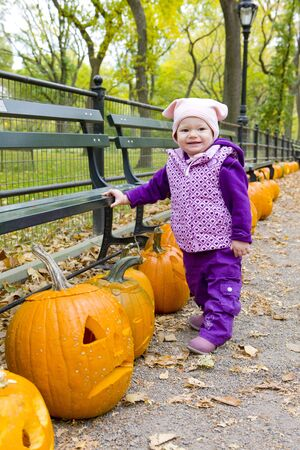 falltime: little girl in autumnal Central Park, New York City, USA