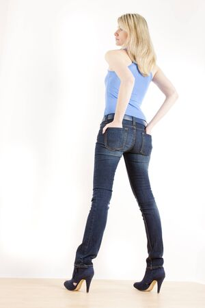 jeans boots: standing woman wearing blue clothes