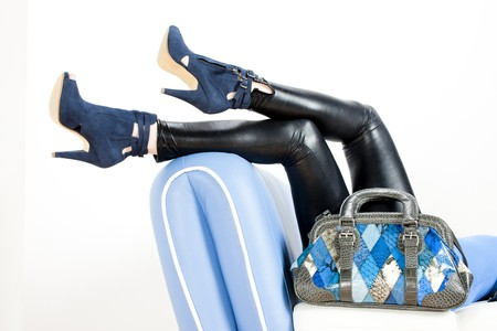 footgear: detail of woman wearing blue shoes and with handbag