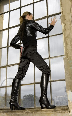 women in boots: woman standing by the window