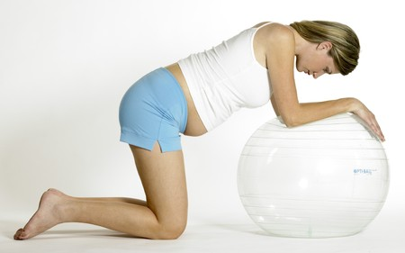 pregnat woman doing exercises photo