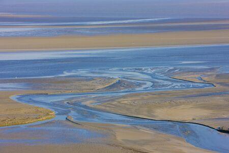 low tide at Mont-Saint-Michel, Normandy, France photo