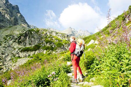 woman backpacker in Great Cold Valley, Vysoke Tatry (High Tatras), Slovakia photo