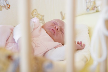 baby in cot photo