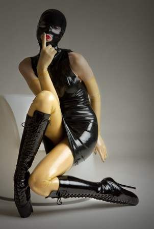 tight dress: woman in latex sitting on the chair