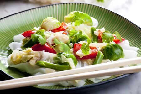 Asian vegetables on coconut milk photo