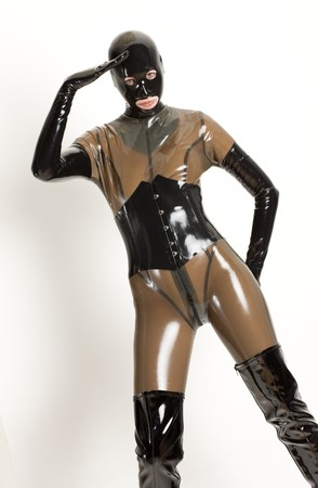 extravagancy: standing woman wearing latex clothes