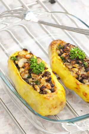 chicken meat: chicken meat with black beans baked in potatoes Stock Photo