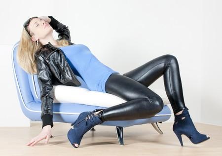 woman wearing fashionable shoes lying on sofa photo