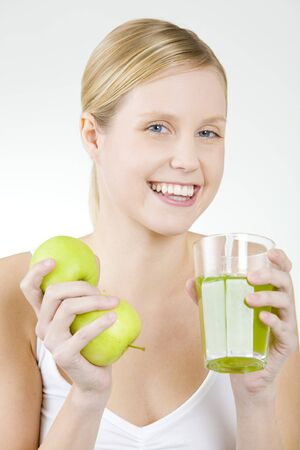 portrait of woman with a glass of juice and apples photo