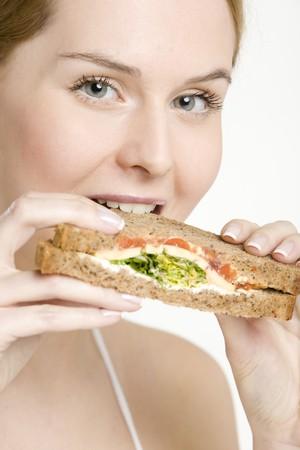 adult sandwich: portrait of woman with sandwich Stock Photo