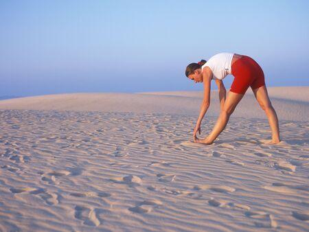 doing exercises, sand dunes, Corralejo, Fuerteventura, Canary Islands, Spain photo