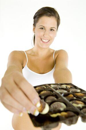 portrait of woman holding chocolate box photo
