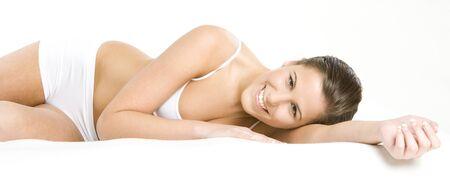 teen underwear: lying down woman wearing underwear Stock Photo