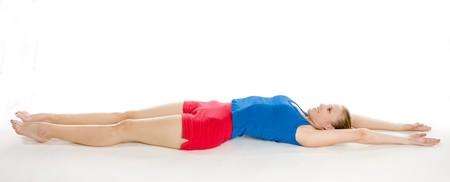 woman lying down: exercising woman