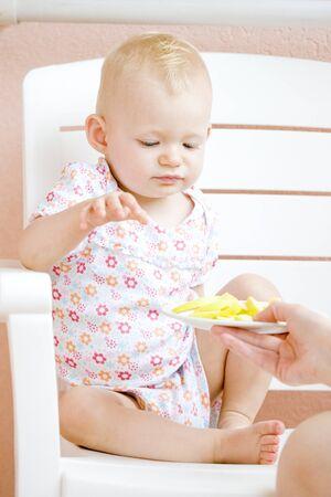 sitting toddler eating an apple Stock Photo - 7502474