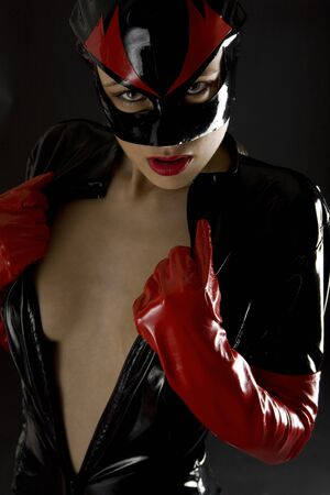 extravagancy: portrait of woman wearing latex clothes