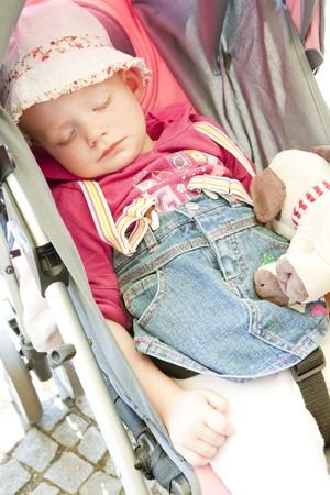 defenseless: portrait of sleeping toddler in pram
