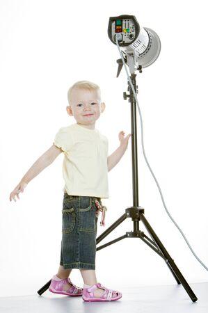 flash light: toddler standing at flash light Stock Photo
