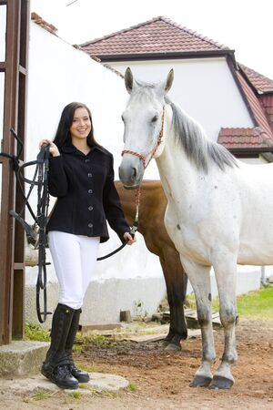dark haired woman: equestrian with horse