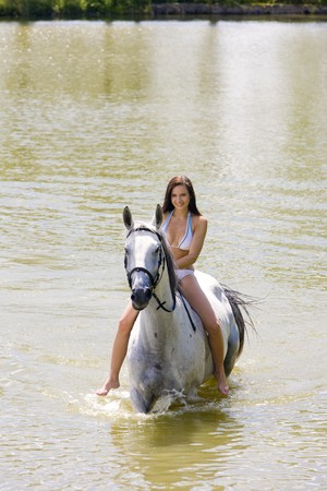 equestrian on horseback riding through water Stock Photo - 7642199