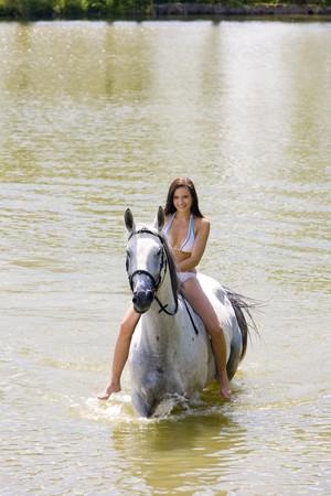 equestrian on horseback riding through water Stock Photo - 7642199