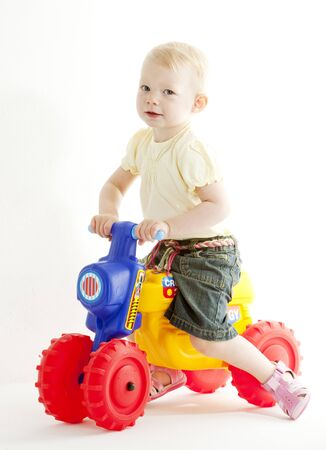 little girl on toy motorcycle Stock Photo - 7642146