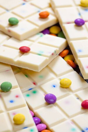 smarties: still life of white chocolate with smarties