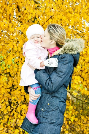 portrait of woman with toddler in autumnal nature photo