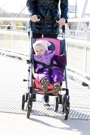 woman with toddler sitting in pram on walk Stock Photo - 7788405