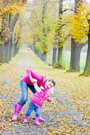 mother with her daughter in autumnal alley Stock Photo - 7787850