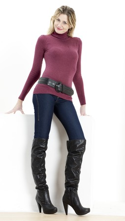 jeans boots: standing woman wearing fashionable boots