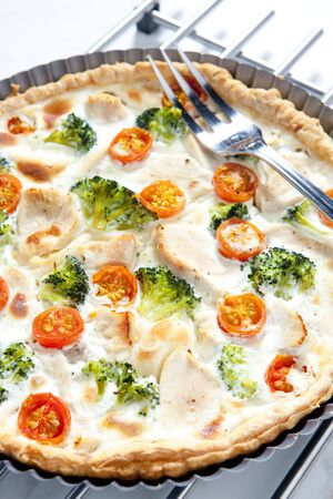 chicken meat: cake with broccoli, cherry tomatoes and chicken meat