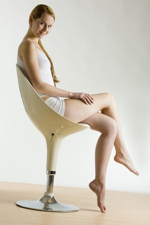 sitting down: woman sitting on chair