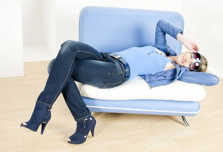 woman wearing blue clothes lying on sofa Stock Photo - 7875717