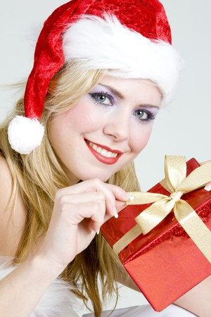 Santa Claus with Christmas present photo