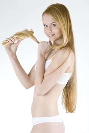 portrait of combing woman wearing underwear photo