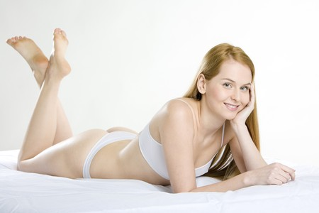 woman lying down: lying down woman wearing underwear Stock Photo