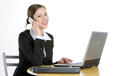 telephoning businesswoman with a laptop photo