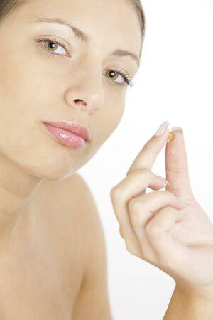 portrait of woman with vitamin E Stock Photo - 7954919