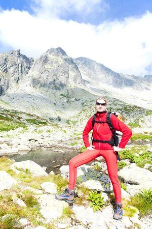 woman backpacker at Five Spis Tarns, Vysoke Tatry (High Tatras), Slovakia photo