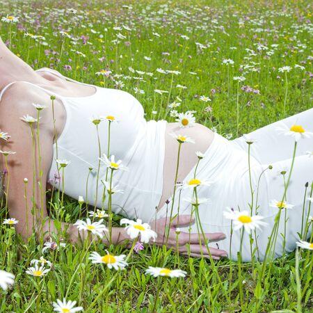 pregnat woman on meadow photo
