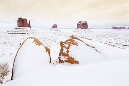 winter The Mittens and Merrick Butte, Monument Valley National Park, Utah-Arizona, USA photo