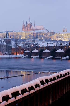 Hradcany with Charles bridge in winter, Prague, Czech Republic photo