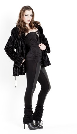 standing young woman wearing black clothes photo